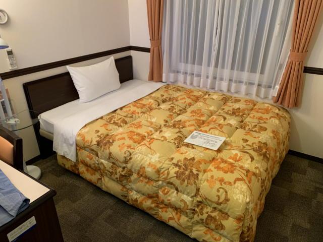 東横イン新大阪駅東口の部屋のベッド